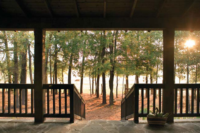 front porch of custom ranch home in East Texas, Designed by Dallas Architect, Steve Chambers, A.I.A., Specializing in Custom Homes in Texas and Oklahoma.