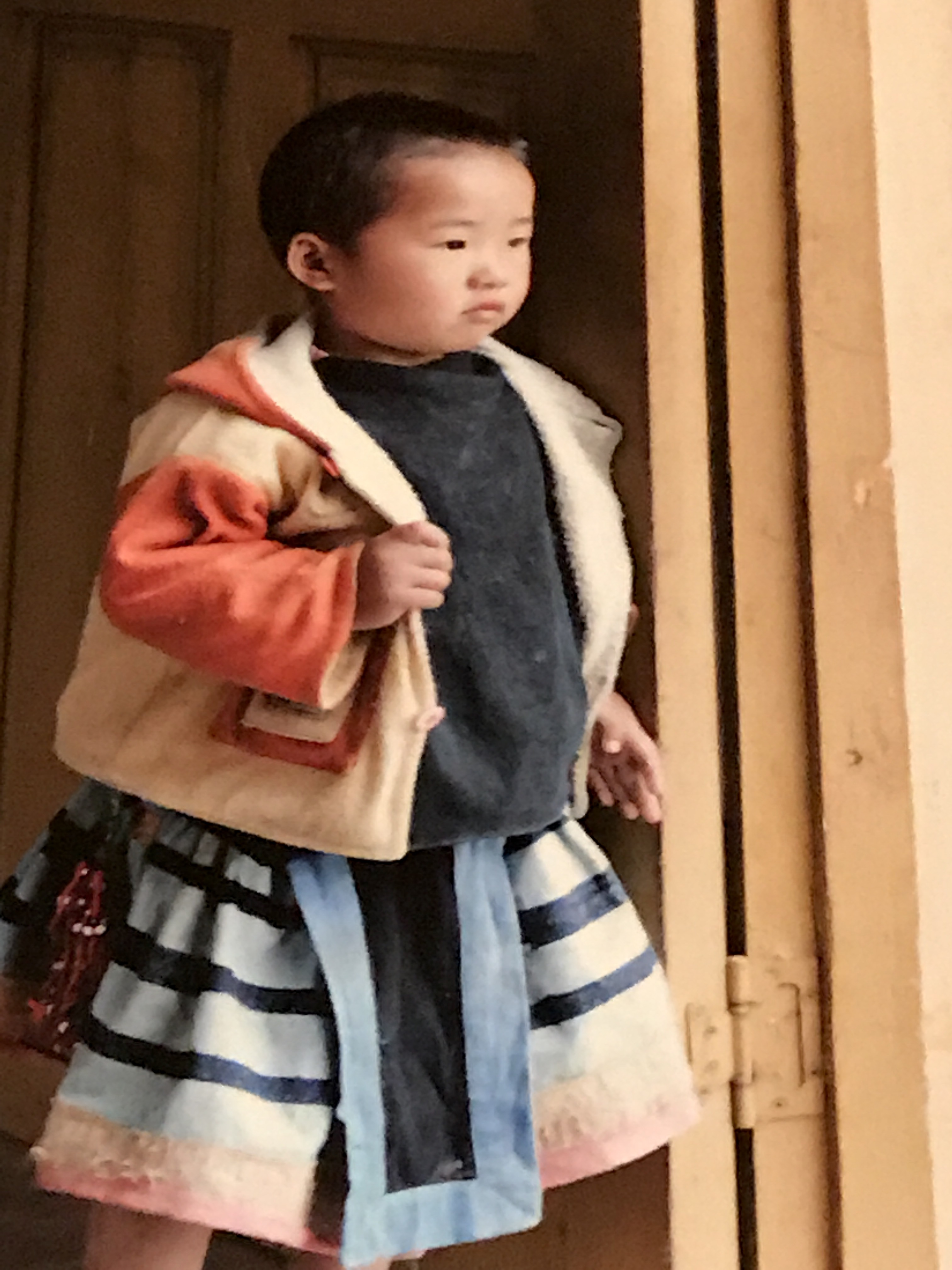 boy in traditional southwest chinese dress quilts of southwest china