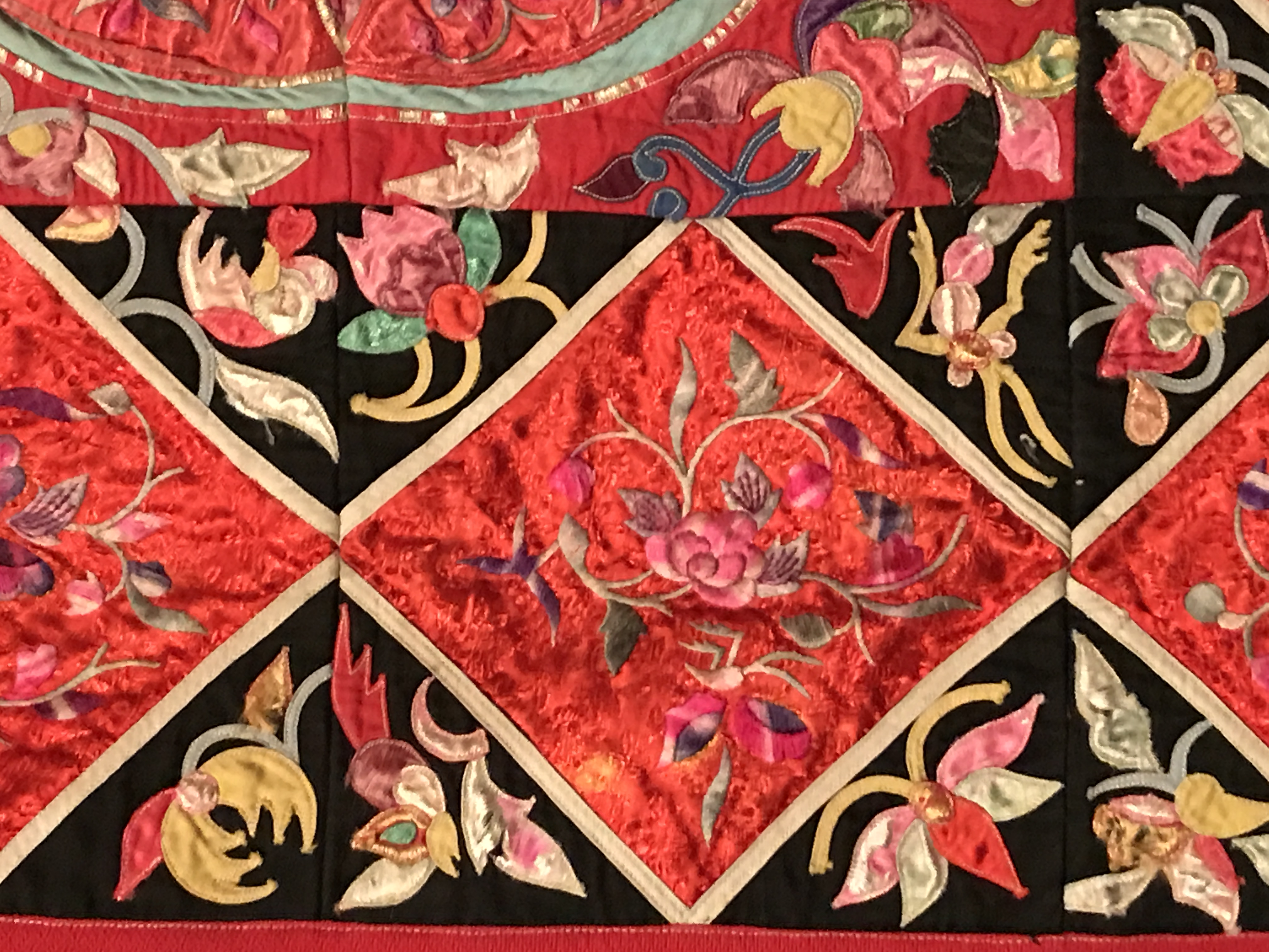 RED AND BLACK QUILT WITH FLOWERS FROM SOUTHWEST CHINA