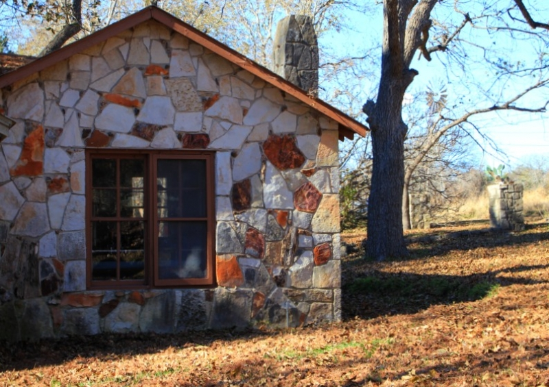 Hill country architect reflects upon blanco river stone homes for Hill country stone