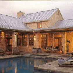 Texas limestone, steeply pitched metal roofing, deep porches and wide overhangs