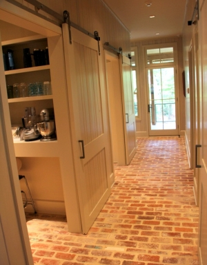 15-antique-brick-floors-barn-doors-kolbe-doors-recycled-brick-floors-texas-lake-house-property